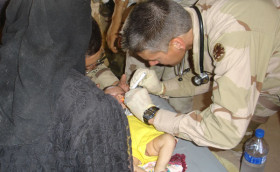 Examining an infant – Iraq